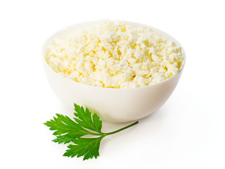 cottage cheese in a white bowl with a sprig of parsley