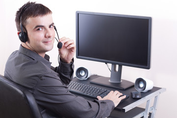 Call center, employee working on computer.