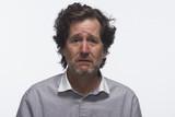 Man looking miserable, horizontal poster