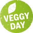 grüner runder button veggy day mit blatt