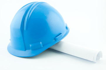 Blue hardhat on papers