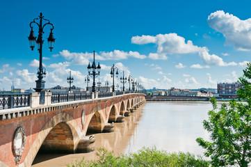 Old stony bridge in Bordeaux, France