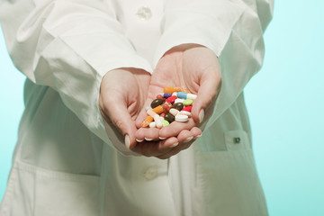 female doctor holding medicine