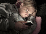 Woman on smartphone at night concept of cheating or affair