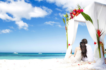 wedding arch decarated with flowers on beach