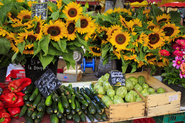 Sunflowers and vegetables for sale at a market in Provence