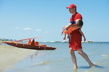 Lifeguard and rescued child