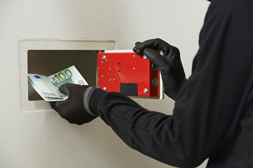 thief burglar at house safe breaking