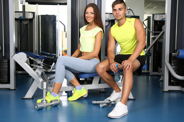 Guy and girl at gym