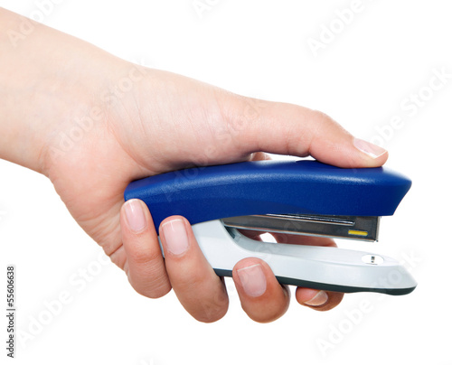 Stapler in woman hand.