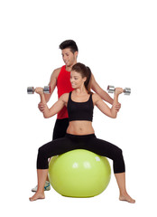 Attractive woman and a personal trainer