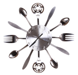 Kitchen clock with spoons and forks. Concept.
