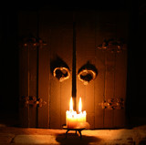 Three burning candles on the closed door background