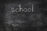 Chalk on black board: school