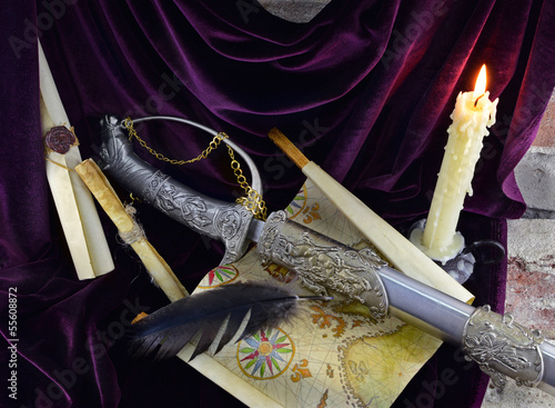 Romantic composition with sword and candle 1