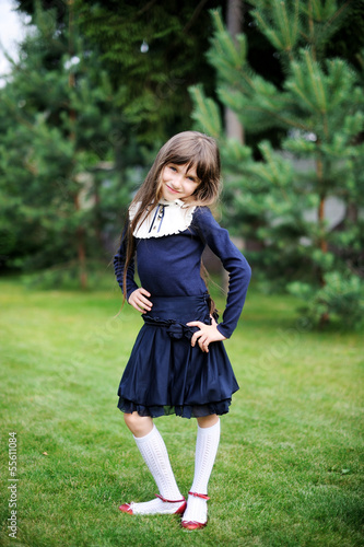 Cute school girl in navy uniform posing