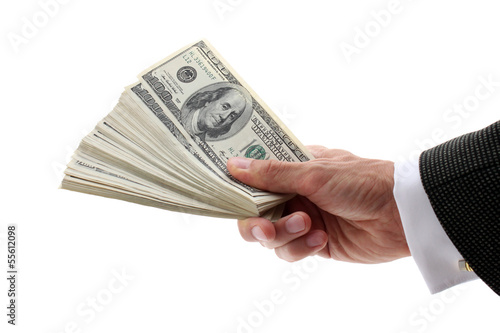 hand holding fan-shaped dollars