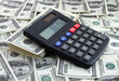calculator on pile of dollars