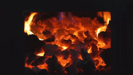 Burning coals in a stove