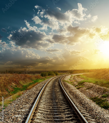 Poster railroad goes to horizon in sunset
