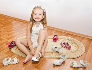 Cute little girl  puts her shoes