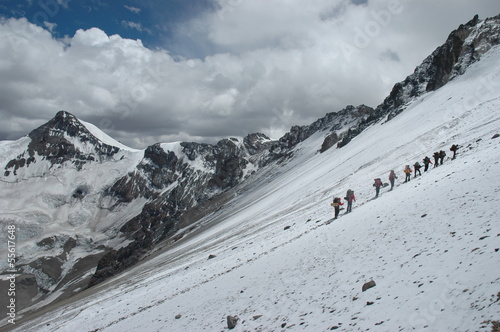Climbers climbing Aconcagua peak in winter conditions