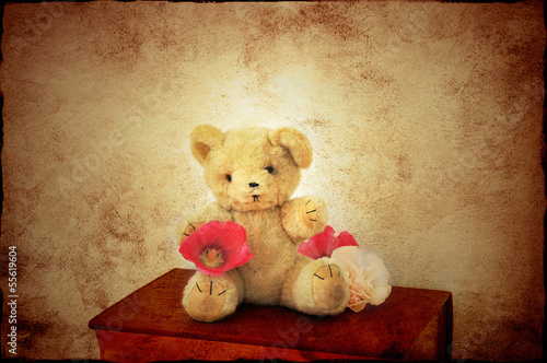 Teddy bear on book
