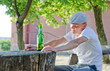 Man enjoying a quiet drink outdoors