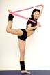 Beautiful sporty woman in black dress slim body with sash
