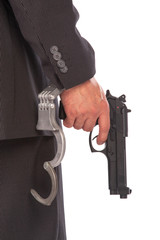 Businessman with gun and handcuffs