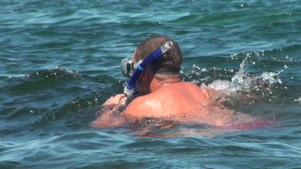 diver in mask before diving into the water of the sea