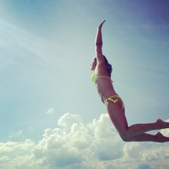 Woman jumping in swimmingpool