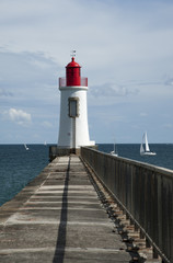 Lighthouse at the end of the harbour wall