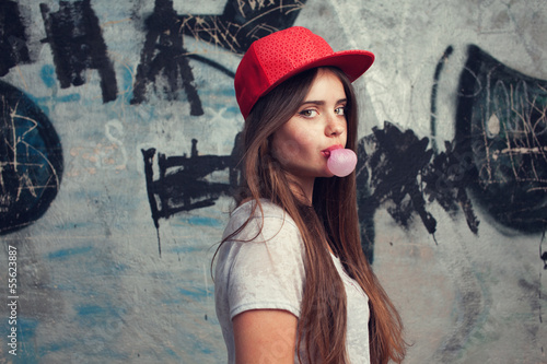 trendy beautiful model  Blowing bubblegum