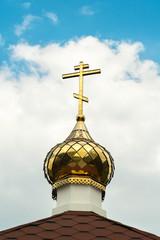 Church cross on the sky background (closeup)