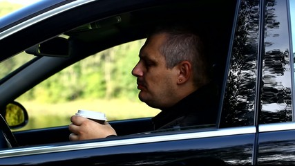 Man with coffee in car episode 1