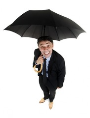 Obsequious businessman holding an umbrella
