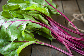 fresh beet leaves (chard) on the table
