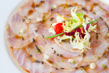Close up of cod carpaccio.