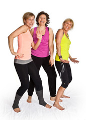 Three cute woman dancing on isolated white background