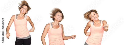 Cute woman dancing on isolated white background