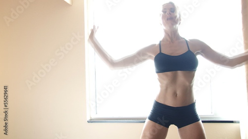 Female dancer practice in front of window