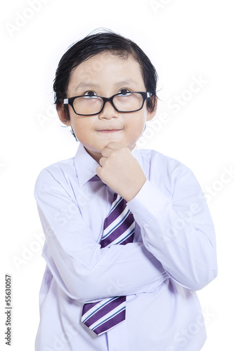 Close-up business kid thinking - isolated