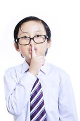 Be quiet. Little businessman gesture on white