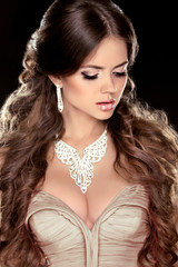 Jewelry. Beauty Woman with Very Long Healthy and Shiny Smooth Br