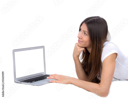 Young woman lying on bed with laptop computer