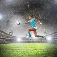 Young woman football player