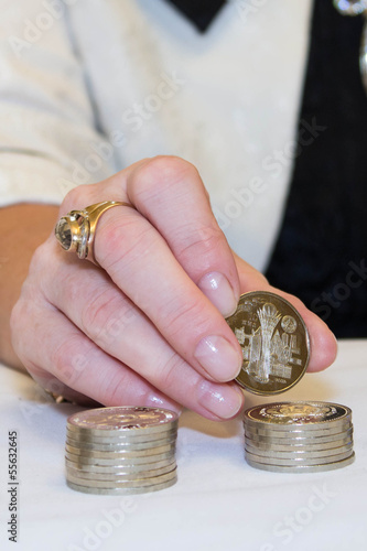 Woman hand with coins