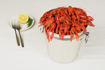 pail full of river lobster served on table