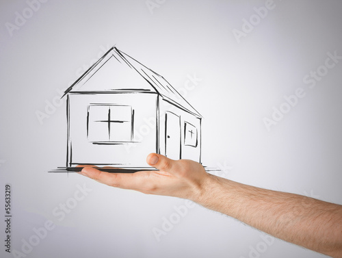 house on virtual screen in man hand